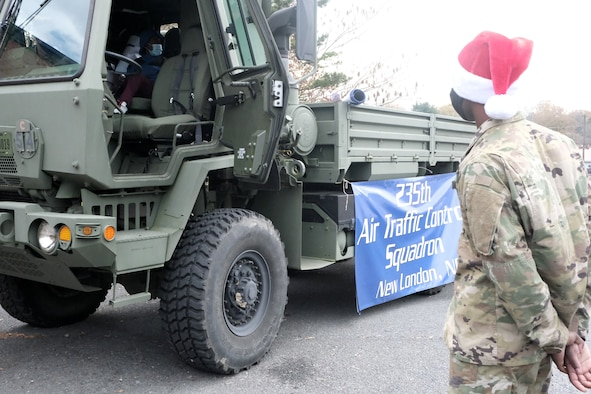 A five-ton truck, M10-35, used by the 235th Air Traffic Control Squadron for hauling beacons onto a flight line, is set-up for Operation Santa Claus held at Oakboro Elementary School in Oakboro, N.C. Dec. 13, 2020. The Chapter 7 organization within the North Carolina Air National Guard hosts the Annual Operation Santa Claus event as a way to reach out to the community and spread holiday cheer and spirit. Chapter 7 and volunteers passed out nearly 100 boxes of food donated by the local Food Lion as well as 50 presents designated to students within the school.