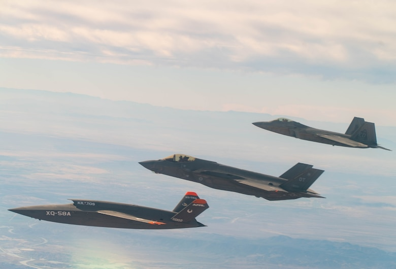 A U.S. Air Force F-22 Raptor and F-35A Lightning II fly in formation with the XQ-58A Valkyrie low-cost unmanned aerial vehicle over the U.S. Army Yuma Proving Ground testing range, Ariz., during a series of tests Dec. 9, 2020. This integrated test follows a series of gatewayONE ground tests that began during the inaugural Department of the Air Force on-ramp last year in December. (Courtesy photo)