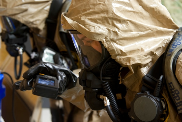 Sgt. Karlee Jones takes pictures of a biological hazard