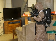 Sgt. Karlee Jones takes pictures of a room