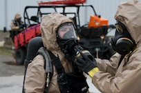 Sgt. Karlee Jones waits for her gas mask to be removed on October 28, 2020 at The Central Missouri Events Center in Columbia, Missouri. Sgt. Jones finished a training exercise involving a biological threat.