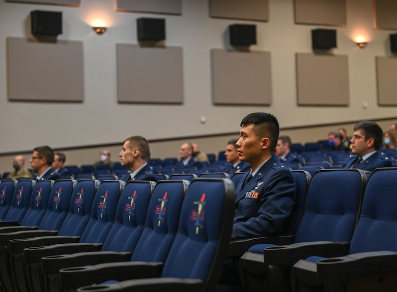Specialized Undergraduate Pilot Training Class 21-03 sit at their graduation ceremony on Dec. 11, 2020, at Columbus Air Force Base, Miss. Students will conduct pilot training for at least a year before graduating from SUPT. (U.S. Air Force photo by Airman 1st Class Davis Donaldson)