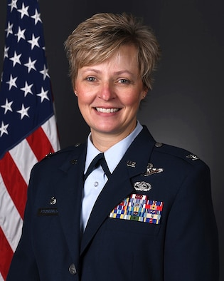 178th Wing Commander Col. Fitzgerald poses for an official portrait. The Background is gray with an American flag on the left. (U.S. Air National Guard photo by Tech. Sgt. Rachel Simones)