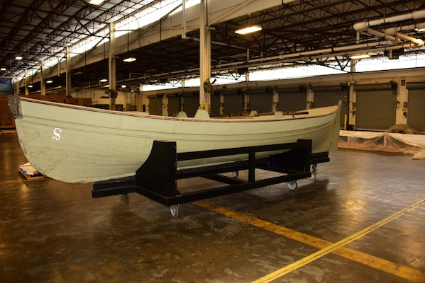 USS Saginaw's gig rests on a steel mount at the Naval History and Heritage Command's collection management facility.