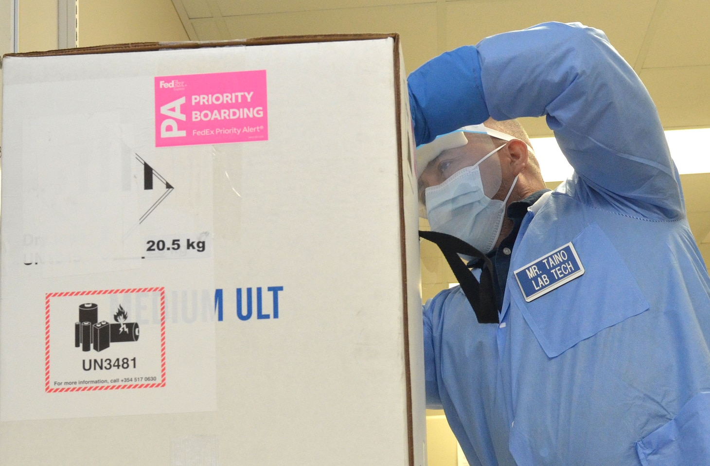 Staff Naval Hospital Jacksonville unpack the first delivery of the Coronavirus (COVID-19) vaccinination on Dec. 15.