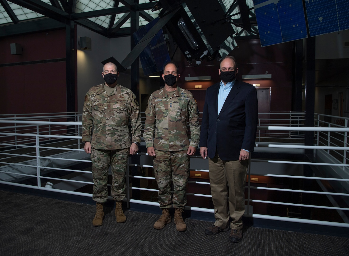 From left to right, Lt. Gen. Thomas Bussiere, United States Strategic Command deputy commander; Lt. Gen. John Shaw, United States Space Command deputy commander; and Ambassador Marshall S. Billingslea, Special Presidential Envoy for Arms Control, pose for a photo Dec. 15, 2020, at USSPACECOM headquarters at Peterson Air Force Base, Colorado.