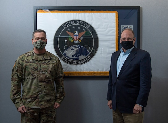 U.S. Army Gen. James Dickinson, United States Space Command commander, and Ambassador Marshall S. Billingslea, Special Presidential Envoy for Arms Control, pose for a photo Dec. 15, 2020, at USSPACECOM  headquarters at Peterson Air Force Base, Colorado.