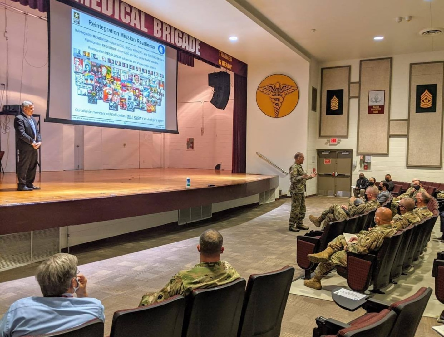 Maj. Gen. Daniel R. Walrath (right), commanding general, U.S. Army South, provides remarks during the Reintegration Working Group mission readiness brief at Evans Auditorium Dec. 3.