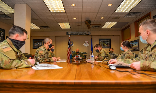U.S. Air Force Col. David Berkland, the 354th Fighter Wing (FW) commander, and Chief Master Sgt. John Lokken, the 354th FW command chief, meets with the innovation team during a wing leadership immersion on Eielson Air Force Base, Alaska, Dec. 11, 2020.