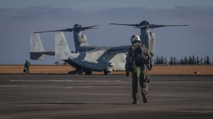 A U.S. Marine with Marine Medium Tiltrotor Squadron (VMM) 265, 1st Marine Aircraft Wing approaches an MV-22B Osprey at the flight line during exercise Forest Light Western Army at Camp Soumagahara, Gunma Prefecture, Japan, Dec. 5, 2020. Forest Light is an annual bilateral training exercise that strengthens the interoperability and readiness of the U.S. Marine Corps and Japan Ground Self-Defense Force to deter aggression and defeat any threat. This iteration is focused on seizing and defending key maritime terrain as an integrated force in support of naval operations in the defense of Japan. (U.S. Marine Corps photo by Sgt. Branden J. Bourque)