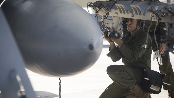 U.S. Marine Corps Lance Cpl. Carlos Rosadonieves, an aircraft ordnance technician with Marine Fighter Attack Squadron (VMFA) 312, loads MK-76 training bombs at Marine Corps Air Station (MCAS) Iwakuni, Dec. 2, 2020. VMFA-312 supported 3rd Marine Division by providing close air support for the exercise at Combined Arms Training Center (CATC) Camp Fuji, Dec. 3, 2020. CATC Camp Fuji is a Marine Corps Installations Pacific Facility dedicated to modernized live, virtual, and constructive combined arms training. CATC Camp Fuji provides premier support for the accomplishment of air, ground, and amphibious training for the Marine Corps, joint U.S. forces, and our allies. (U.S. Marine Corps photo by Lance Cpl. Bryant Rodriguez)