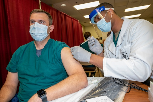 A doctor gets vaccinated.
