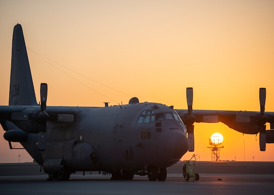 A U.S. Air Force EC-130H Compass Call assigned to 41st Expeditionary Electronic Combat Squadron sits parked on the ramp at Al Dhafra Air Base, United Arab Emirates, Dec. 2, 2020.