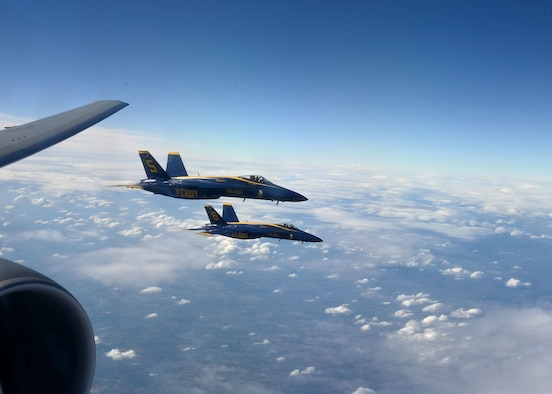Two F/A-18 Super Hornets of the U.S. Navy's Blue Angels flight squadron fly alongside a Pease KC-46A Pegasus refueler Dec. 12, 2020, in Georgia airspace. The jets were refueled for a flyover at the Army-Navy Game in West Point, N.Y. The Pease aircrew teamed with another KC-46A from McConnell AFB, Kan.