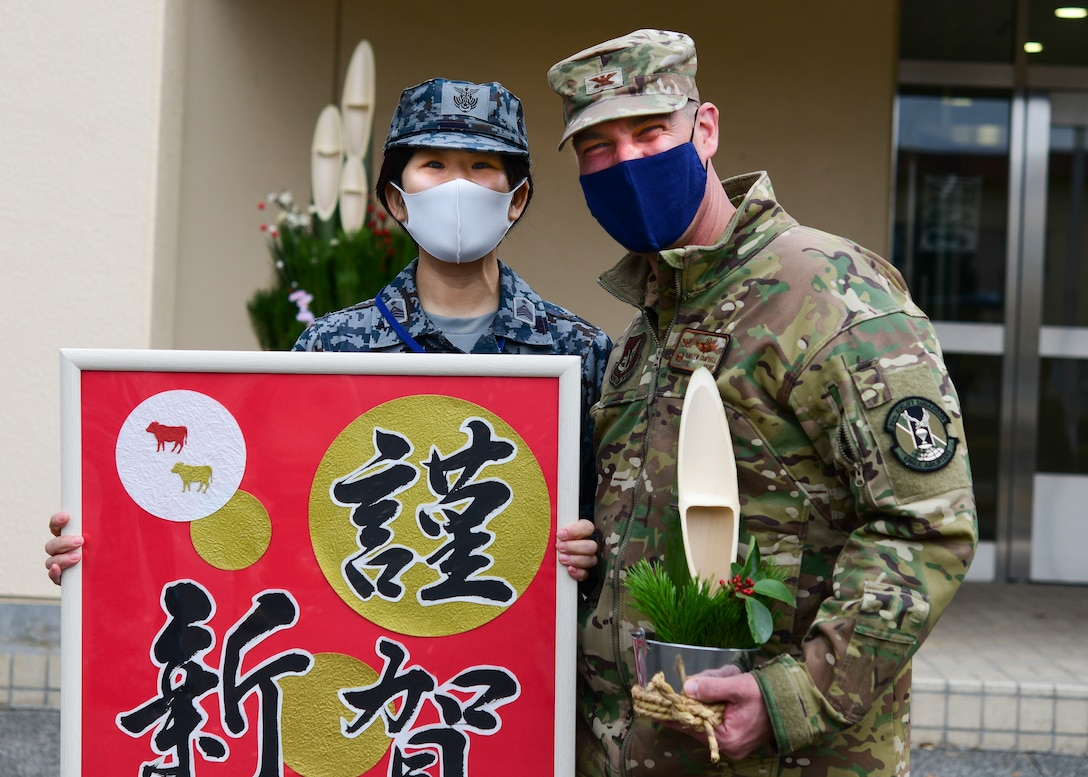 Japanese Airman gives gift to military commander