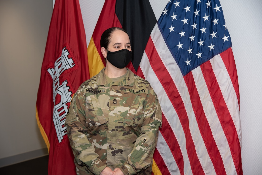 U.S. Army Master Sgt. Betsy Weintraub receives the Meritorious Service Medal from U.S. Army Corps of Engineers, Europe District commander.
