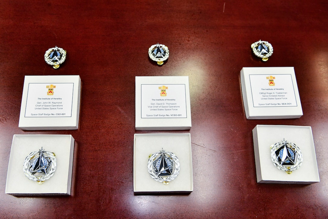 U.S. Space Force Space Staff Badges are displayed before an unveiling ceremony at the Pentagon, Arlington, Va., Dec. 11, 2020. Service members assigned to Space Force at the Pentagon will wear the badge.
