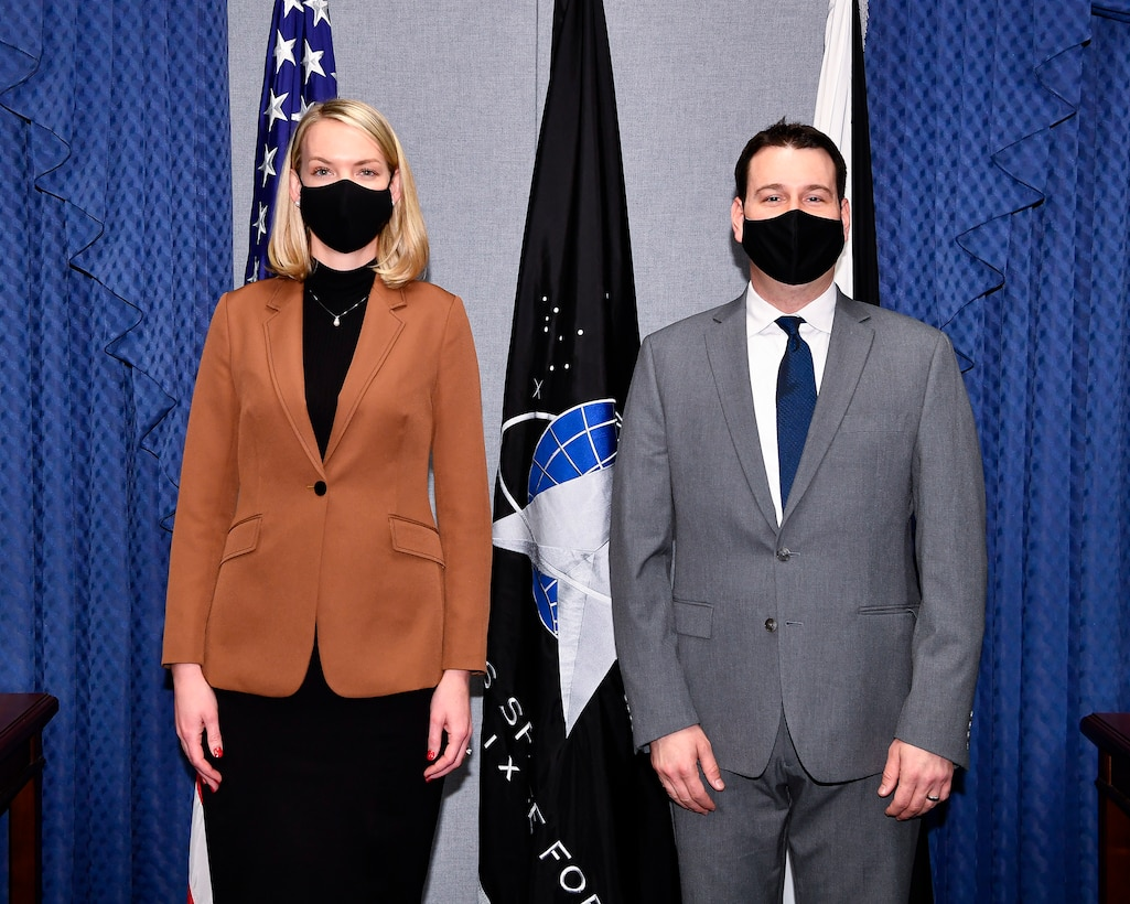 Alison Wargo, left, an illustrator with the Institute of Heraldry, and division chief Andrew Wilson pose before a ceremony at the Pentagon unveiling the U.S. Space Force Space Staff Badge, Arlington, Va., Dec. 11, 2020. Service members assigned to Space Force at the Pentagon will wear the badge.