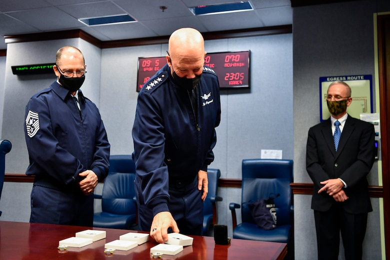 Chief of Space Operations Gen. John W. Raymond examines U.S. Space Force Space Staff Badges before an unveiling ceremony at the Pentagon, Arlington, Va., Dec. 11, 2020. Service members assigned to Space Force at the Pentagon will wear the badge