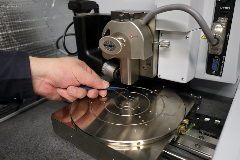 A sample is loaded into the Bruker Atomic Force Microscope system capable of performing nanoscale imaging experiments. (U.S. Air Force photo/Spencer Deer)