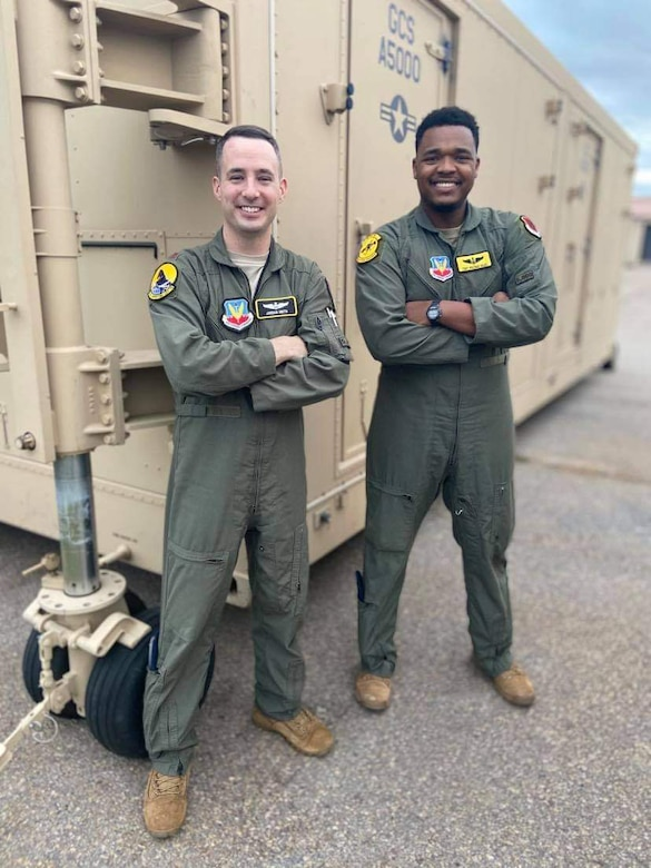 Maj. Jordan Smith, 25th Operations Support Squadron assistant director of operations, and Tech. Sgt. Abishai Giles, 482nd Attack Squadron sensor operator.