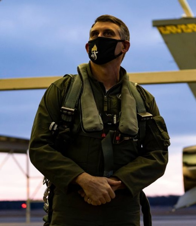 A photo of a man in a flight suit.