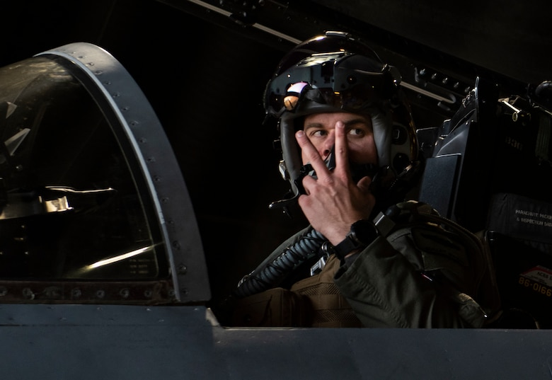 U.S. Air Force Capt. John Bynum, an electronic combat pilot assigned to the 493rd Fighter Squadron, gives the signal for engine start prior to take-off at Royal Air Force Lakenheath, England, Dec. 8, 2020. 48th Fighter Wing pilots participated in a live missile fire exercise, gaining combat representative training that can't be fully imitated in a simulation during day-to-day training. (U.S. Air Force photo by Airman 1st Class Jessi Monte)