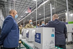 Operation Warp Speed co-leaders Dr. Moncef Slaoui and GEN Gus Perna visit a UPS Freezer Farm in Louisville, Kentucky. The visit was among several industry visits solidifying distribution solutions and the mission's whole-of-America approach.