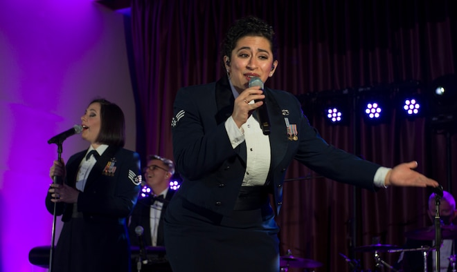 Senior Airman Alycia Cancel, U.S. Air Force Band of the Pacific vocalist, sings during the Sounds of the Season show at the Officer's Club on Yokota Air Base, Japan, Dec. 15, 2020. Cancel sang to a live and virtual audience to spread holiday joy. (U.S. Air Force photo by Staff Sgt. Joshua Edwards)