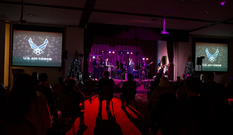 Audience members watch as the Air Force Band of the Pacific plays their Sounds of the Season show on Yokota Air Base, Japan, Dec. 15, 2020. The band performed holiday classics, with a modern twist. (U.S. Air Force photo by Staff Sgt. Joshua Edwards)