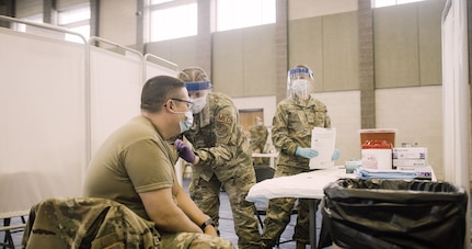 Approximately 200 Indiana National Guard Soldiers and Airmen received the COVID vaccination on Dec. 16, 2020, at the Johnson County Armory in Frankllin, Ind. The Guard members have been on the front lines of the fight against the coronavirus, working at nursing homes, food banks and elsewhere.