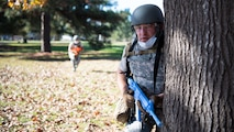 Tech. Sgt. Michael Tomaszewski, Operational Medical Readiness Squadron medical technician, positions himself behind a tree during a Tactical Combat Casualty Care (TCCC) field training exercise at Barksdale Air Force Base, La., Dec. 9, 2020.