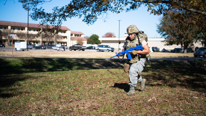 Staff Sgt. Jelisa Adams, 2nd Healthcare Operations Squadron medical technician, runs during a Tactical Combat Casualty Care (TCCC) field training exercise at Barksdale Air Force Base, La., Dec. 9, 2020.