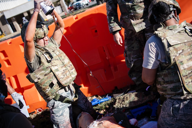 Staff Sgt. Johanna Esquivel, left, 2nd Operational Medical Readiness Squadron medical technician, provides tactical field care to a training dummy during a Tactical Combat Casualty Care (TCCC) field training exercise at Barksdale Air Force Base, La., Dec. 9, 2020.