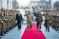 Gen. Mark A. Milley, chairman of the Joint Chiefs of Staff, walks through an honor cordon with Gen. Mohammad Yasin Zia, Chief of General Staff of the Afghan Armed Forces at the presidential palace prior to a meeting with Ashraf Ghani, President of the Islamic Republic of Afghanistan in Kabul, Dec. 17, 2020.  The senior leaders discussed the current security environment in Afghanistan.