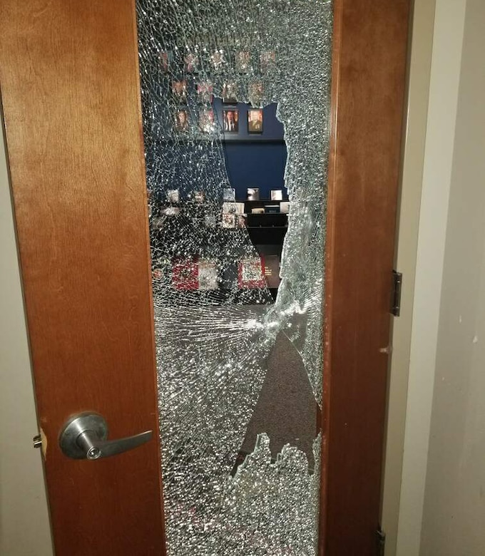 A door with glass damage