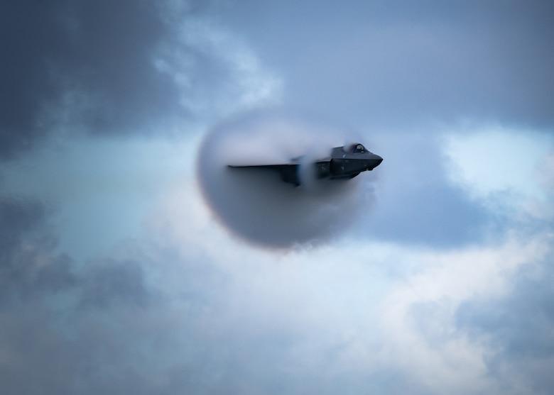 An F-35A Lightning II performing a high-speed pass maneuver.