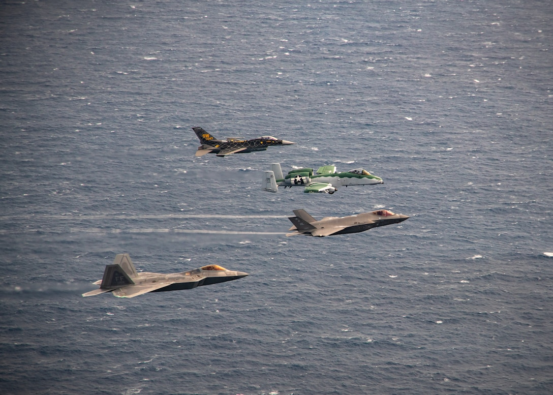 The four Air Combat Command jet demonstration teams fly in formation over the Atlantic Ocean near Florida.