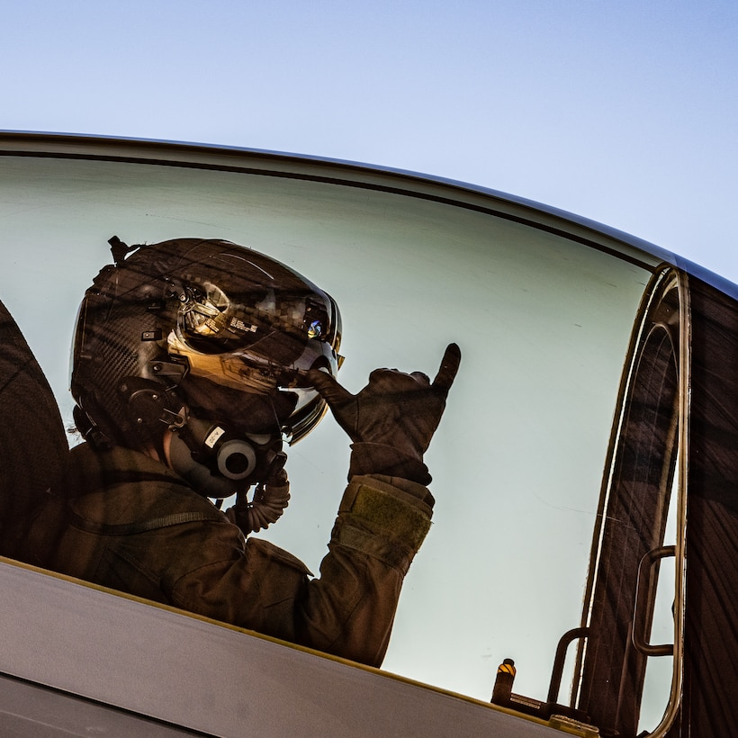 The F-35A Lightning II Demonstration team pilot signals to a maintainer prior to takeoff.