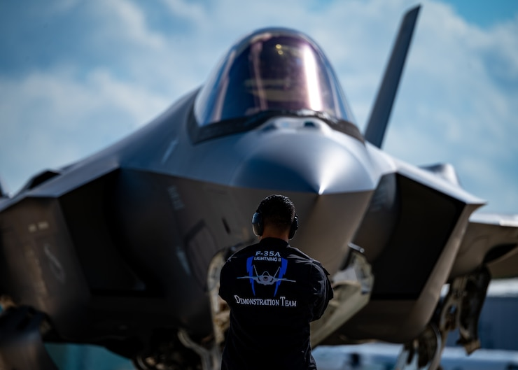 An F-35A Lightning II Demonstration Team crew chief prepares to launch out an F-35 for a flight.