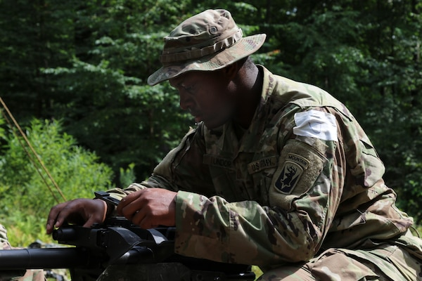 An Army specialist with 1st Squadron, 172nd Cavalry Regiment of the Vermont Army National Guard conducts their annual Spur Ride at the Camp Ethan Allen Training Site in Jericho, Vermont, Sept. 6, 2020. The soldiers were tested on mission essential tasks as they completed a 6.5-mile ruck march. (U.S. Army National Guard Photo by Cpl. Gillian McCreedy, 172nd Public Affairs Detachment, Vermont National Guard)