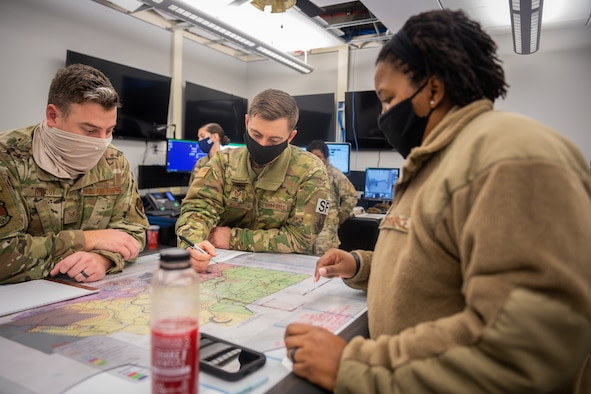 Tech. Sgt. Joseph McCoy, Tech. Sgt. Eric Hill, 2nd Security Forces Squadron flight chiefs, and Master Sgt. Tamieka Morgan, 2nd SFS defense force operator, search for a route to a crash site at Barksdale Air Force Base, La., Dec. 16, 2020. Airmen from the 2nd SFS, 2nd Civil Engineer Squadron, 2nd Medical Group, 2nd Logistics Readiness Squadron and local authorities worked in conjunction to locate and effectively respond to a civilian light aircraft crash on the east side of Barksdale. (U.S. Air Force photo by Senior Airman Lillian Miller)