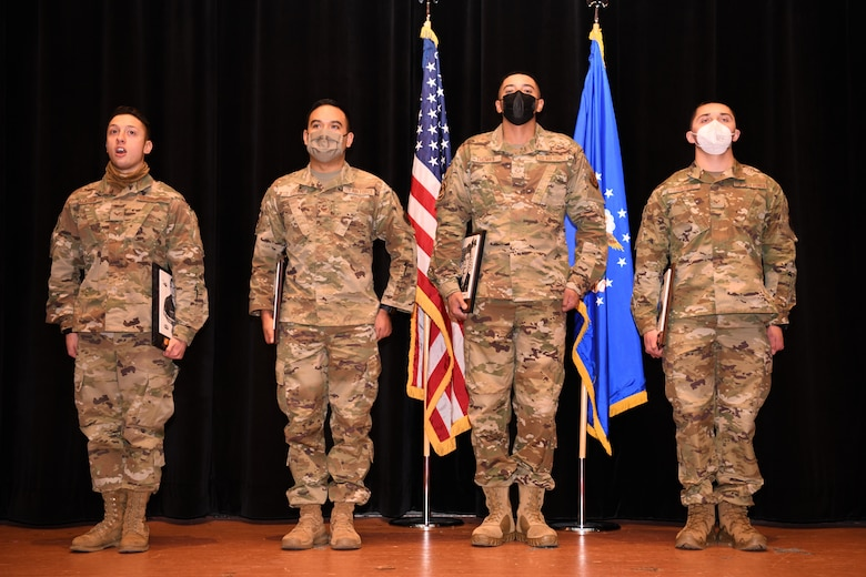 Award winners of ALS Class 21-B stand for recognition during their class graduation Dec. 17, 2020, on F. E. Warren Air Force Base, Wyo.