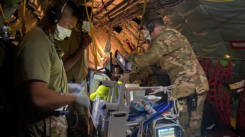 Image of Airmen providing medical care.