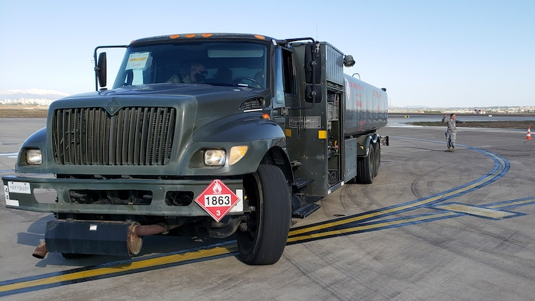 a fuel truck sits on the flight line
