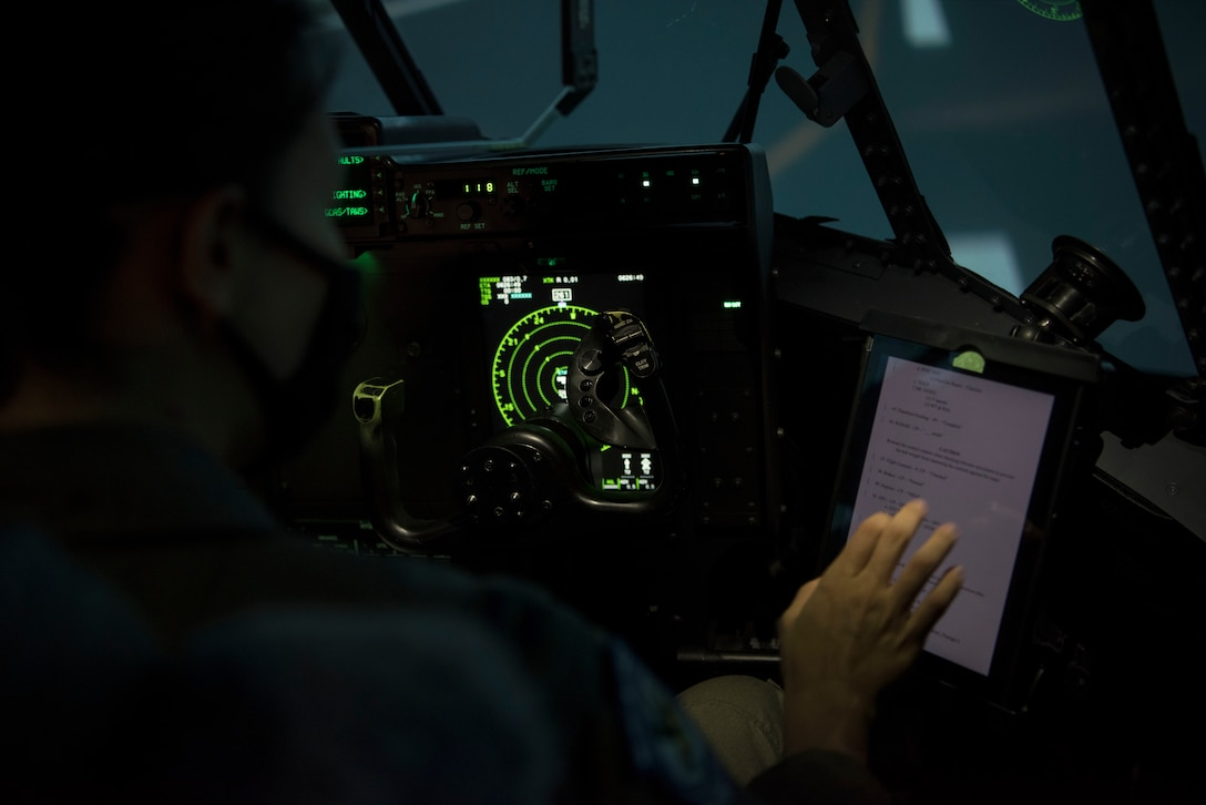 An individual uses a C-130 simulator at Ramstein Air Base, Germany.