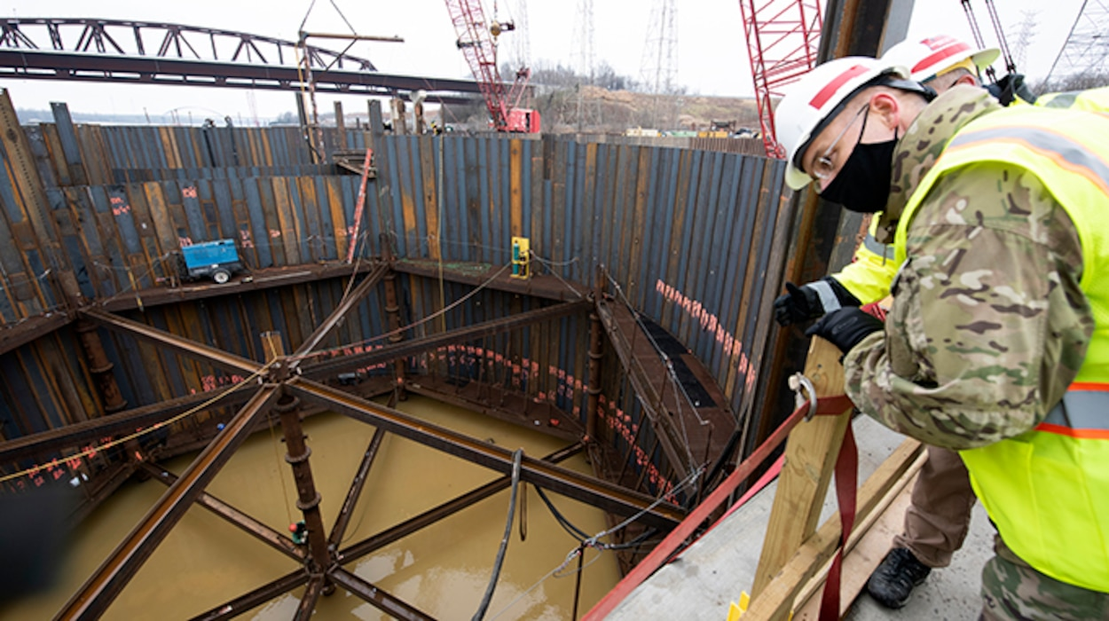 Maj. Gen. William (Butch) H. Graham, U.S. Army Corps of Engineers commanding general for Civil and Emergency Operations, overlooks ongoing construction of a cofferdam cell by a Johnson Brothers work crew at the Kentucky Lock Addition Project Dec. 16, 2020 at Grand Rivers, Kentucky, where the U.S. Army Corps of Engineers Nashville District is constructing the new 110-foot by 1,200-foot navigation lock at the Tennessee Valley Authority project. (USA CE Photo by Lee Roberts)