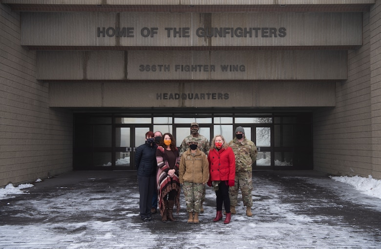 Members of Mountain Home Air Force Base COVID-19 Task Force congregate outside the 366th Fighter Wing Headquarters' building, at MHAFB, Idaho, 16 Dec., 2020. Consisting of multiple squadrons, the CTF was developed to understand and synthesize COVID travel and mitigation guidance from various Air Force, DoD and public health authorities. (U.S. Air Force photo by Airman 1st Class Gary Hilton)