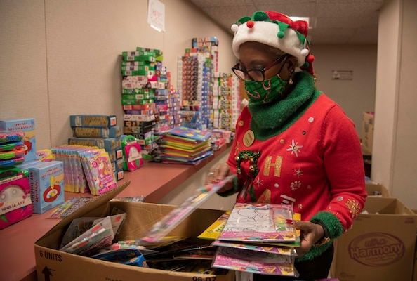 Nita Ford-Hightower, Child Youth Education Services, arranges toys and games donated from members of the community for the School Liaison Toy Drive Dec. 17, 2020, at Joint Base San Antonio-Fort Sam Houston, Texas.