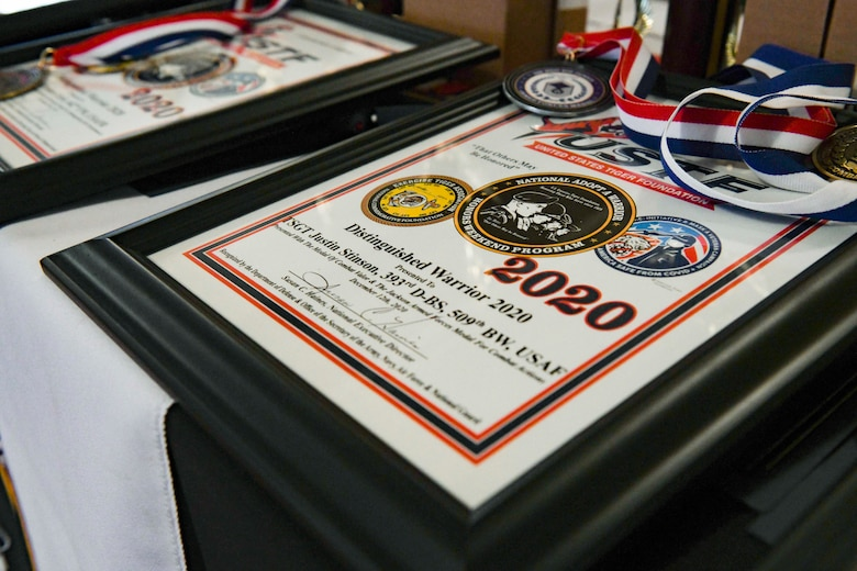 A United States Tiger Foundation award plaque and medals sit on a table prior to an official ceremony at Columbia, Missouri, Dec. 12, 2020. The Exercise Tiger Association hosted the program and honored service members and units for their outstanding achievements and meritorious service. Team Whiteman closely works with its local community to support each other through events and recognition ceremonies. (U.S. Air Force photo by Staff Sgt. Sadie Colbert)